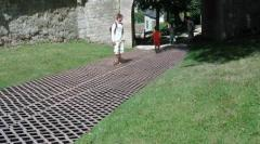 Massive grass tiles made of grey recycled plastic