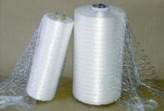 Pallet wrapping film and wrapping net