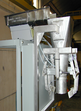 Gross weight dosing machine with vibrating gutter