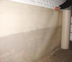 Système de finition pour surfaces murales humides,